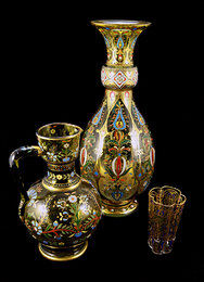 Typical Hungarian motifs decorate a jug, a vase and a tumbler made by Henrik Giergl ~1896